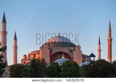 The last golden rays of sun illuminating Hagia Sophia in Istanbul Turkey.