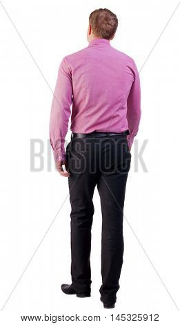 back view of walking  business man.  going young guy in red shirt. stylishly dressed in formal wear young man. Isolated over white background. guy comes to the workplace. Rear view people collection