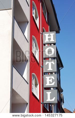 hotel sign on building exterior. vertical signage.
