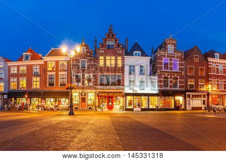 Typical Dutch houses on the Markt square in the center of the old city at night, Delft, Holland, Netherlands