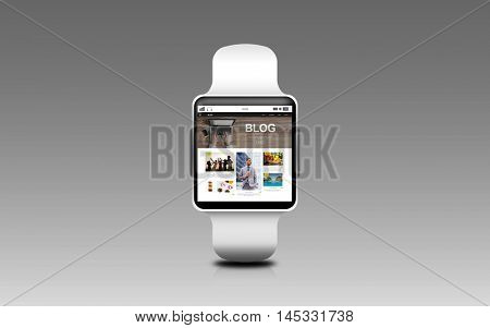 modern technology, internet, object and blogging concept - close up of black smart watch with blog web page on screen over gray background