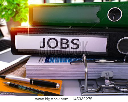 Black Office Folder with Inscription Jobs on Office Desktop with Office Supplies and Modern Laptop. Jobs Business Concept on Blurred Background. Jobs - Toned Image. 3D.