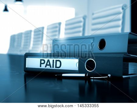 Ring Binder with Inscription Paid on Wooden Working Desktop. Paid. Business Concept on Blurred Background. Paid - Business Illustration. Paid - Office Folder on Working Black Desktop. 3D Render.