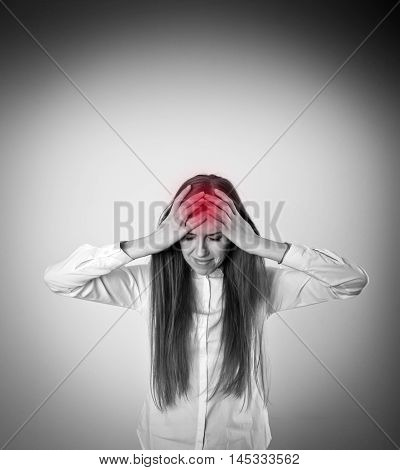 Headache and symptom concept. Sad and Unhappy woman in white. Tears welled up in her eyes.