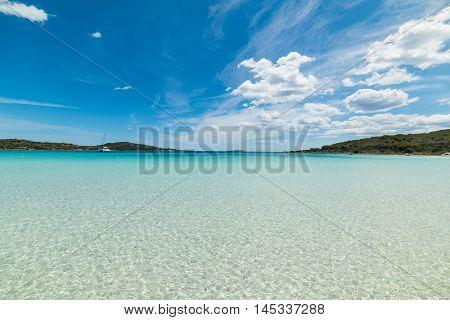 cala brandinchi under a bue sky with clouds Sardinia