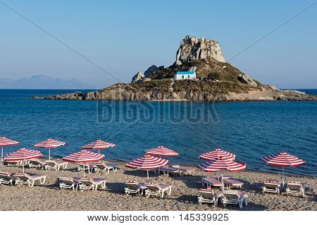 Landscape with sandy beach and islet in Kos island, Greece