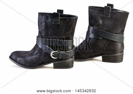 Womens black suede fashion boots isolated. Shot in studio on a white background.
