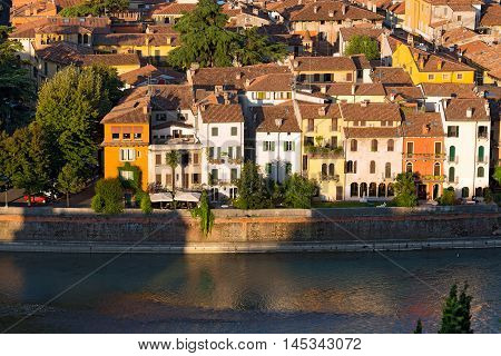 Houses along the Adige River (aerial view) in the Verona city. UNESCO world heritage site - Veneto Italy