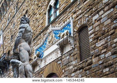 Hercules and Cacus statue with Palazzo Vecchio in the background Florence