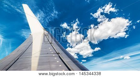 an aiplane wing in the blue sky
