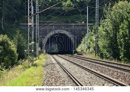 Railway corridor with a tunnel. Double-track electrified railway.