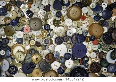 An assortment of old vintage buttons layed out flat - just like grandma used to have. Suitable for a background.