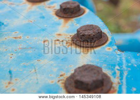 closeup Big rusty metal Screws and nuts locked with rust