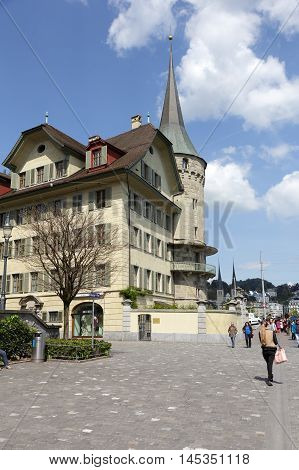 LUCERNE SWITZERLAND - MAY 04 2016: Haus zur Gilgen one of the oldest stone houses in the city and is located on the right bank of the river Reuss.