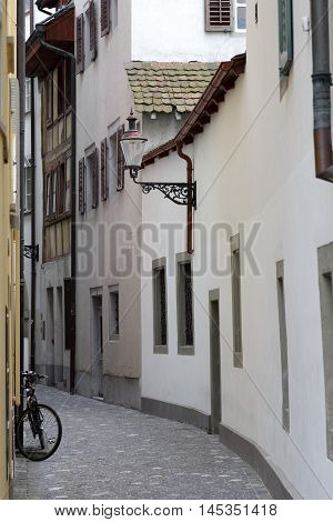 Lucerne Switzerland - May 11 2016: Narrow street in the old town and the bike standing against a wall of the building. Lucerne it is a city in central Switzerland. This is Capital City of the Swiss Canton of Lucerne.