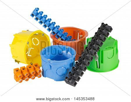 electrical boxes with components for use in electrical installations on white background