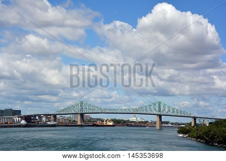 MONTREAL CANADA 08 30 2016:The Jacques Cartier Bridge is a steel truss cantilever bridge crossing the Saint Lawrence River from Montreal to Longueuil in Montreal, Quebec, Canada