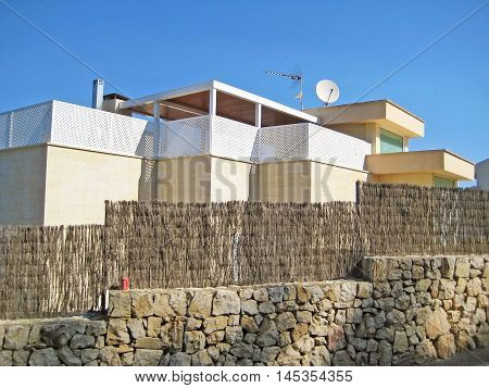 modern villa / house with wall and fence blue sky