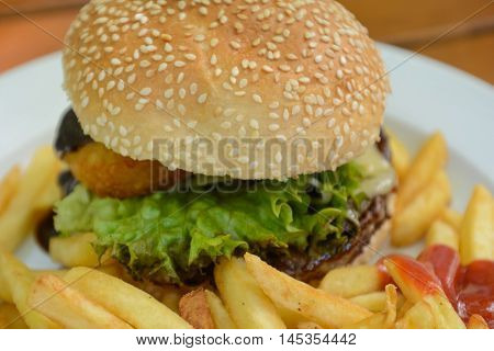 Hamburger with salad and pommes - fast food Closeup
