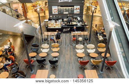 VIENNA, AUSTRIA - JUN 6, 2013: Interior of city cafe inside the moderm shopping mall with customers on June 6, 2013. Vienna city has population near 1.8 million