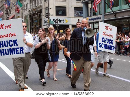 New York City - June 27 2009: Senator Charles Schumer marching in the 40th anniversary gay pride parade on Fifth Avenue