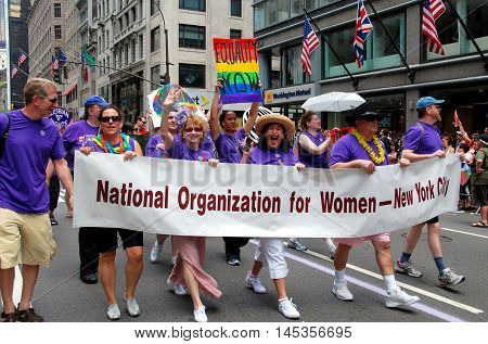 New York City - June 27 2009: National Organization for Women marchers at the 40th anniversary gay pride parade on fifth Avenue