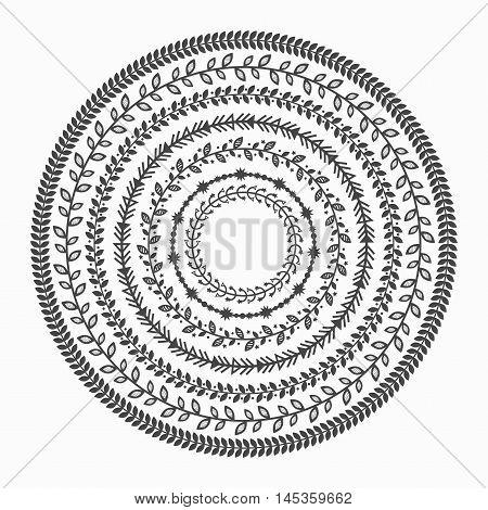Black silhouette inner circles leaves border patterns emblems on white background