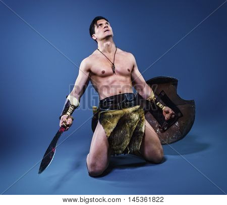 half-naked man in the image of ancient warrior barbarian.