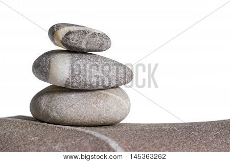 stacked rounded stone pebble arrangement in white back
