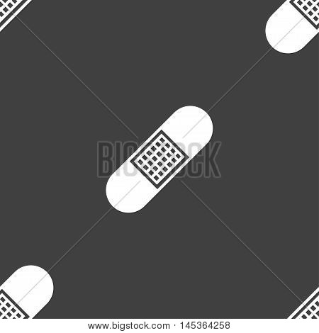 Band Aid Icon Sign. Seamless Pattern On A Gray Background. Vector