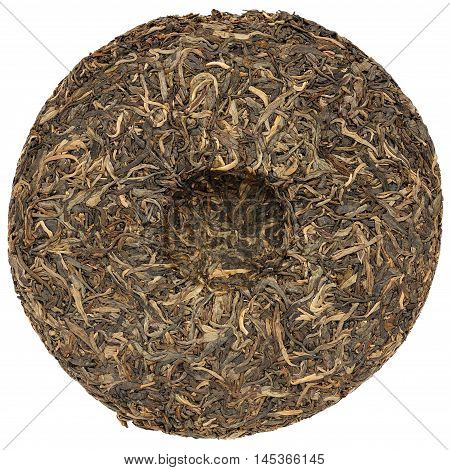 Yunnan raw puerh tea with stone impress isolated