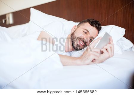 Man Texting His Girlfriend In Bed