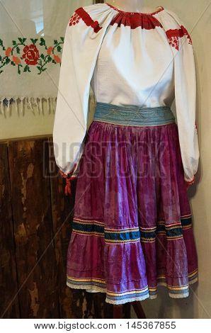 Ukrainian national costume embroidered shirt and red skirt