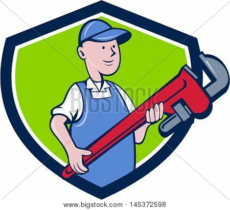 Illustration of a mechanic cradling holding giant pipe wrench looking to the side viewed from front set inside shield crest on isolated background done in cartoon style.