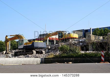 MAGDEBURG, GERMANY - AUGUST 13, 2016: Demolition of the residential building
