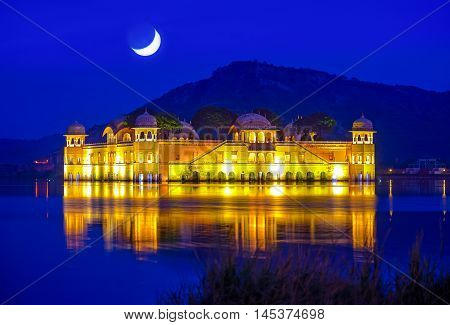 The palace Jal Mahal at night. Jal Mahal (Water Palace) was built during the 18th century in the middle of Man Sager Lake. Jaipur Rajasthan India.