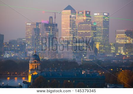 LONDON, UK - OCTOBER 31, 2015: Panorama of Canary Wharf in night. View includes the park, Royal chapel, Painted hall and Greenwich park