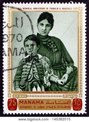 MANAMA - CIRCA 1970: a stamp printed in Manama shows the Young Franklin Delano Roosevelt with his Mother circa 1970