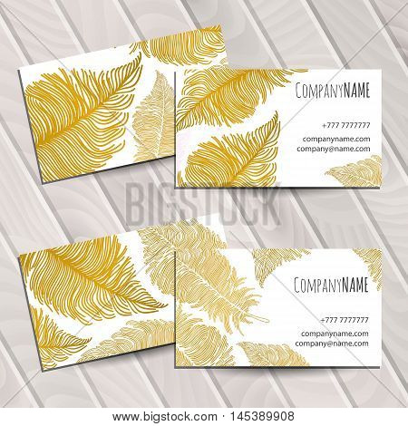 Business card with bright gol boho feathers
