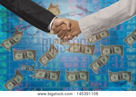 Business Handshake. Business Handshake And Business People Concept. Two Men Shaking Hands Over Money