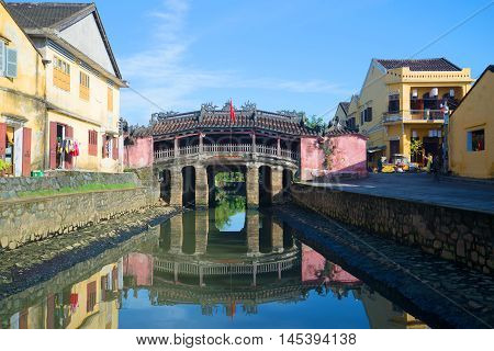 HOI AN, VIETNAM - JANUARY 04, 2015: View of the old Japanese bridge on a Sunny morning. Historical landmark of the city Hoi An, Vietnam