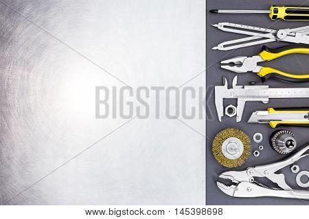 Tool Set Of Wise Grips, Vernier Caliper, Pliers And Screwdriver On Gray Background