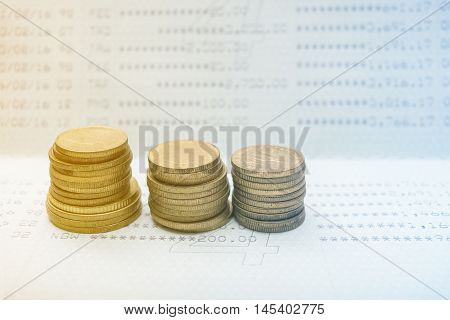 Stack of gold coins with account bank or bank book save money and save life with filter color
