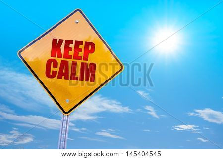 keep calm word on yellow traffic sign blue sky background
