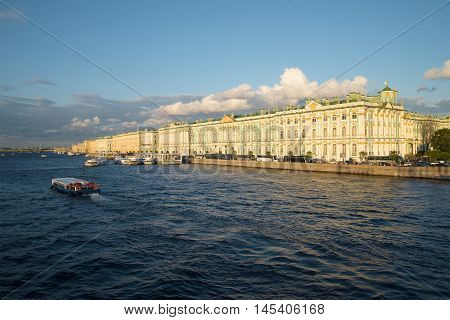 SAINT PETERSBURG, RUSSIA - AUGUST 09, 2016: View of the Winter Palace and Palace Embankment august evening. Historical landmark of the city St. Petersburg