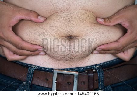 Fat asian man with a big belly.