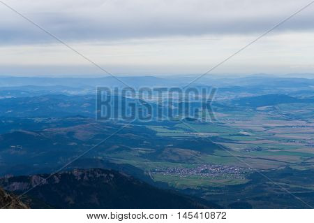 landscape with mountains in slovakia, high tatras, view of the earth from a great height, the villages and the fields, three and a half kilometers above the ground