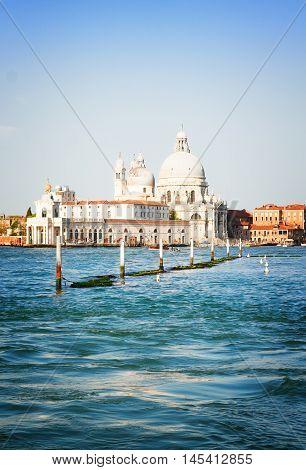Basilica Santa Maria della Salute and Grand canal water, Venice, Italy, retro toned