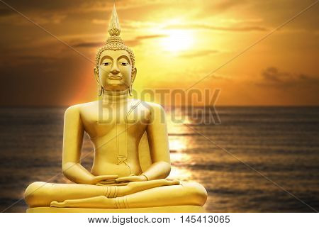 Gold Image Of Buddha In Blurred Sunrise Or Sunset Moment , With Seascape, Light Effect Added In Back