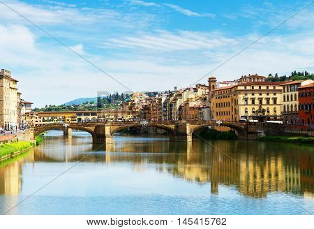 Ponte Santa Trinita bridge and Ponte Vecchio bridge over the Arno River, Florence, Italy, retro toned
